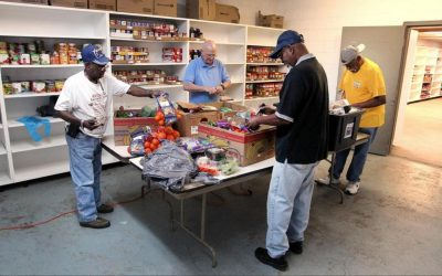 Workers at Crisis Assistance Ministry Food Bank